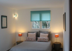 bed with cushions and lamps La Romarine